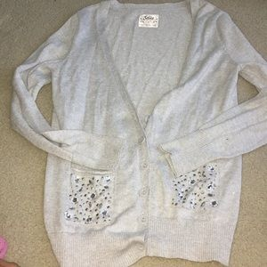 Silver cardigan with bejeweled pockets